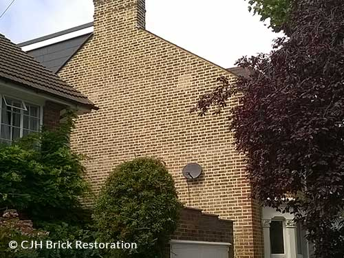 Flank wall re-pointed in lime Twickenham by CJH Brick Restoration